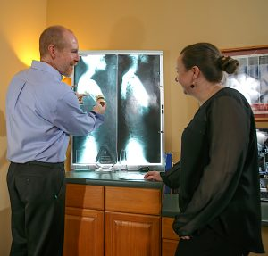 x ray reading with patient Chamberlain Chiropractic Best chiropractor West Chester PA